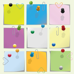 Multicolored note paper with push pins and clips collection