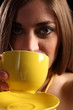 Close up of beautiful woman drinking cup of tea