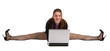 Girl in black suit makes splits and works with laptop.