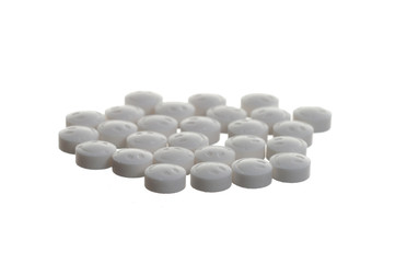 Isolated smiling  white pills over white background