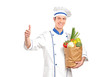 Chef giving thumb up and holding a grocery bag