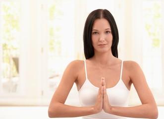Happy woman exercising meditation