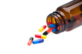 Open pharmaceutical bottle which spills colored capsules poster