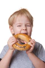 boy eats a bagel