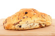 raisin bread on wooden cutting board over white background