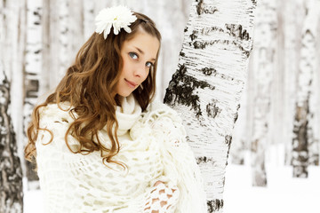 Pretty woman in a winter forest