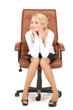 young businesswoman sitting in chair.