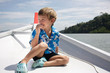 young boy traveling on boat