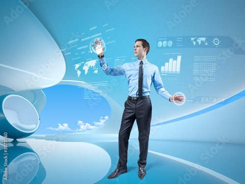 Young businessman navigating holographic virtual interface