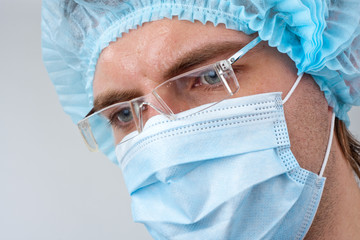 Sweat surgeon in surgical mask