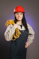 Tradeswoman In Coveralls, Holding An Extension Cord