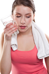 Sporty woman holding water