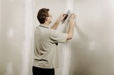 Man Using A Putty Knife poster