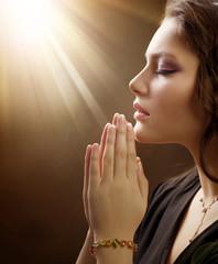 Portrait of a girl praying