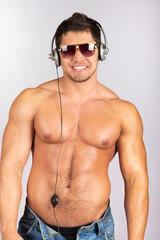 handsome man enjoying music on headphones