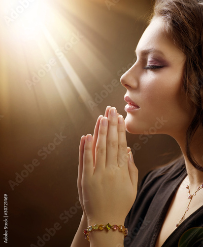 Portrait of a girl praying