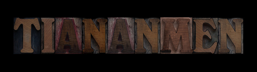 the word Tiananmen in old letterpress wood type