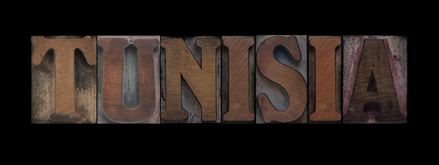 the word Tunisia in old letterpress wood type