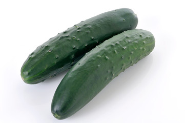 Two whole cucumbers on white background