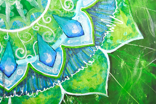 closeup of bright green painted picture with circle pattern, man - 30729060