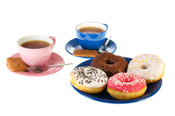 Cups of tea with donuts