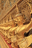 The Grand Palace in Bangkok. Gold ornamental patter statuettes.