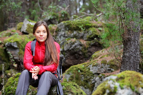Hiking woman in forest