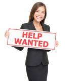 Woman showing help wanted sign