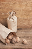 walnuts in a kraft paper bag