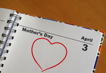 Mother's Day calendar with a red heart
