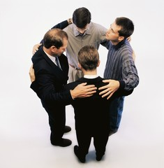 High Angle View Of Men Praying And Standing In A Circle