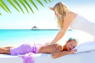 Caribbean turquoise beach massage woman