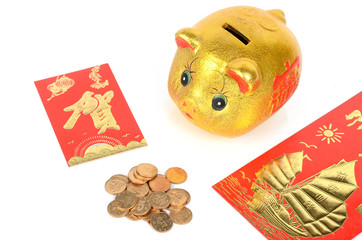 Piggy bank and red packet with coins