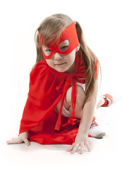 Superhero girl in a red