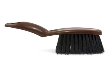 Brown brush for cleaning  on  white background