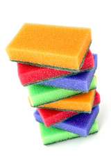 Brightly colored sponges on white background with copy space