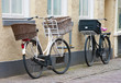 two bicycles with baskets