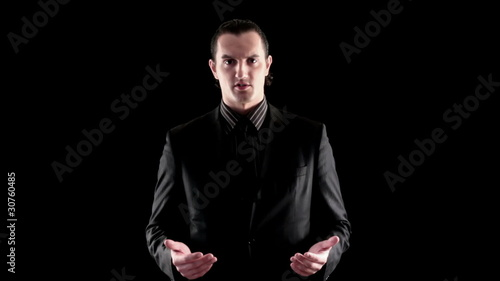 businessman speaking on black background