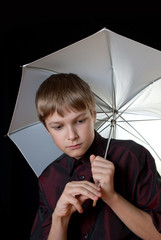 Portrait of a young man. In his hands he held a white umbrella.