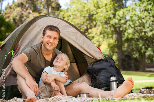 Father and his son camping