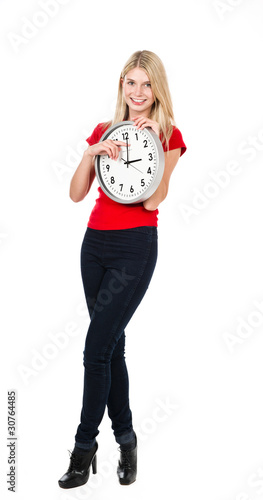 Blonde beautiful girl with the clock
