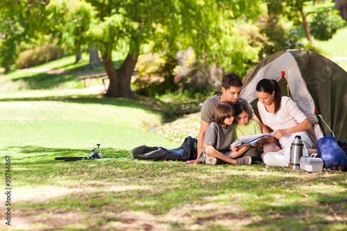canvas print picture Joyful family camping in the park
