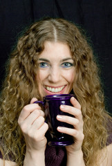 Woman drinking coffee and smiling