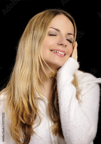 Girl enjoying softness of her jumper