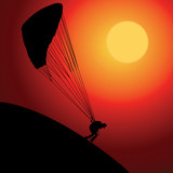 Paraglider over sunset