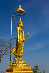 Golden buddha image with blue sky