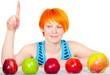 Smiling cute red hair woman choosing apple