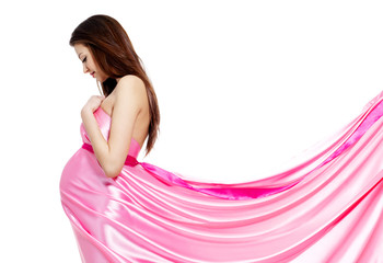 Pregnant woman in rosy dress isolated on white