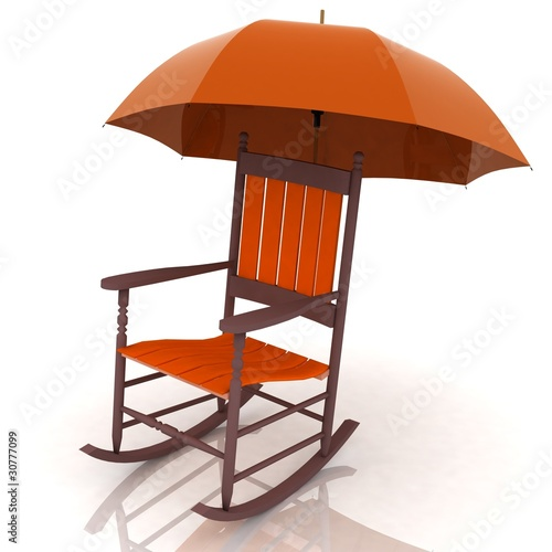 old rocking chair with an umbrella isolated on white background