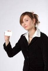 Business woman holding a blank card, isolated